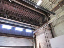 Interior view of Five Boroughs Brewing Co. Brewery before Interior Painting.